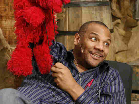 Elmo and Clash, on the Sesame Street set in 2006.