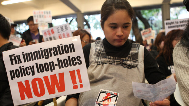 Joyce Wong, a pregnant 30-year-old, takes part in a January 15 protest against immigration laws that allow babies born in Hong Kong to mainland Chinese mothers to be eligible for residency, education and medical care in the territory. Hong Kong residents fear the influx of mainlanders will further burden overtaxed resources.