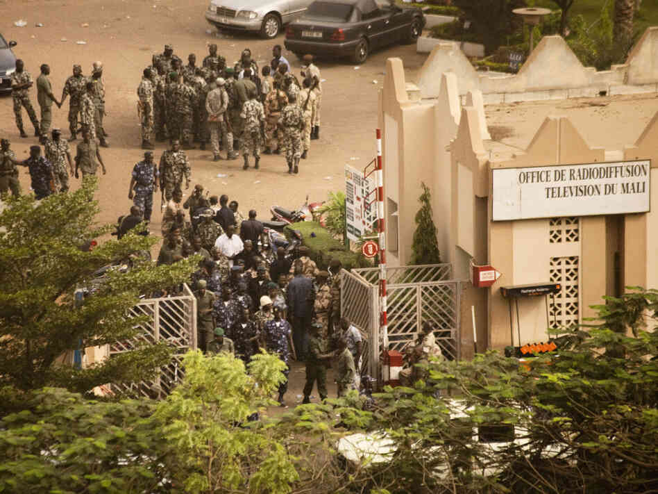 Soldiers gather at the offices of the state radio and television broadcaster after announcing a coup in Mali's capital, Bamako, on Thursday. The soldiers said they ousted the president because he wasn't doing enough to halt a rebel insurgency.