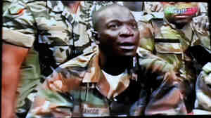 The leader of the junta that seized power in Mali, Army Capt. Amadou Sanogo, announces a curfew in the capital, Bamako, on Thursday, in this photo taken from television.The coup ousted an elected president who was due to step down after a new election next month in the West African nation.