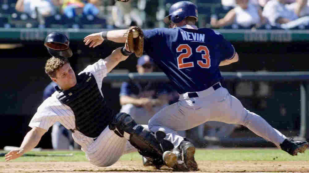 Colorado Rockies catcher Ben Petrick, left, holds on to the ball after tagging out San Diego Padres baserunner Phil Nevin at Coors Field in Denver on Thursday, Sept. 27, 2001.