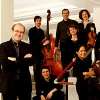 Bernard Labadie (third from left) and his ensemble, Les Violons du Roy, team up with soloists for Bach's St. John Passion at Carnegie Hall.