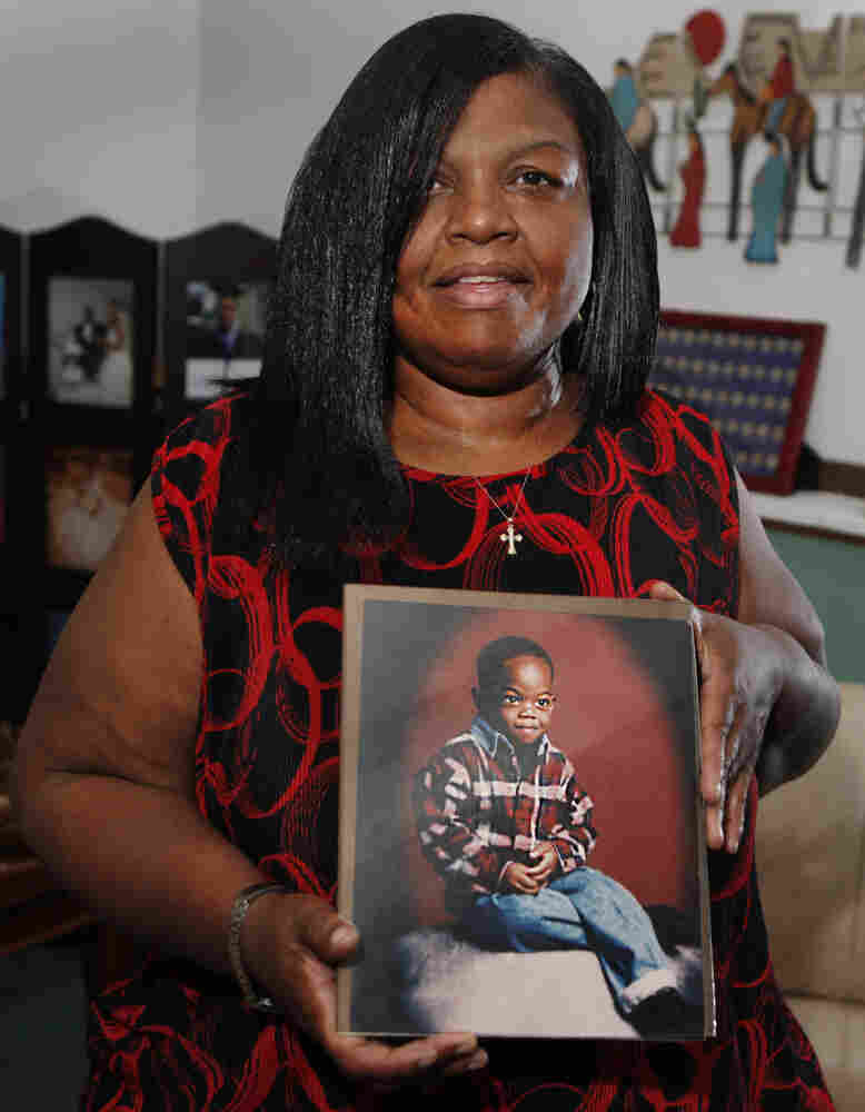 Sharletta Evans holds a photograph of her 3-year-old son Casson in Aurora, Colo., last July. Casson was killed in a drive-by shooting by two 15-year-olds.