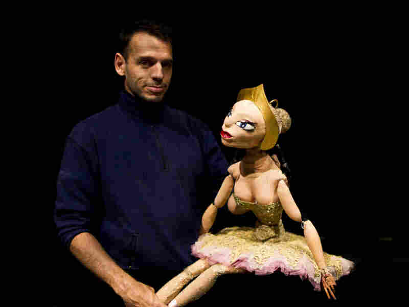 Puppeteer Basil Twist poses with Ballerina, the marionette at the center of a tragic love triangle in his adaptation of Petrushka.