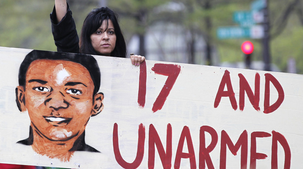 Feriha Kaya attends a rally demanding justice for Trayvon Martin on Saturday in Washington, D.C. Protesters have demonstrated over the case in several cities. (AP)