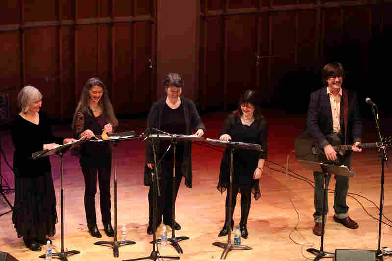 """I can't believe this is happening,"" said the Mountain Goats' John Darnielle of his collaboration with the vocal quartet Anonymous 4, which took place as part of the Ecstatic Music Festival at New York City's Merkin Concert Hall on March 24, 2012."