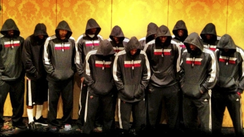 Miami Heat players wear team hoodies in this image posted to LeBron James' Twitter page. NBA stars Dwyane Wade and James decided Thursday to make their reactions to Trayvon's death public. (AP)