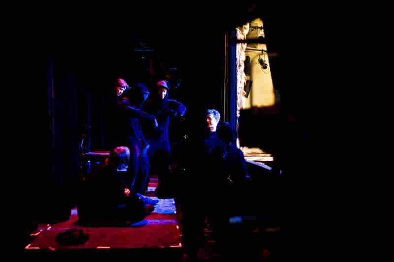 It takes three people, dressed from head to toe in black, to manipulate each puppet in Petrushka.