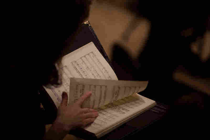 A member of the chorus, La Chapelle de Quebec looks at the score of Bach's St. John Passion, which he wrote for Good Friday services in Leipzig, in April of 1724.