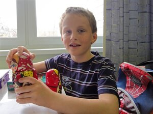 Artyom Savelyev, now 9, plays with a Matryoshka doll in a children's hospital in Moscow in 2010. The American woman who adopted him sent him back to Russia two years ago.