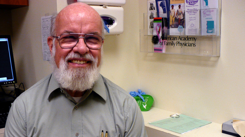 Dr. Glenn Hodges, a volunteer at Health Partnership Clinic in Johnson County, Kan., says he will continue to focus on those without coverage even if the clinic he volunteers at accepts Medicaid and private coverage. (KCUR)