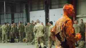 Members of the 182nd Infantry Regiment arrive in Indiana after spending a year in Afghanistan. They will spend about a week here before returning to their homes in New England.