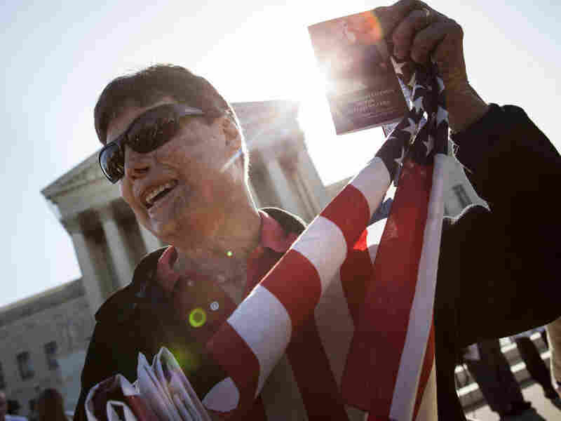 A protester holds up a copy of the U.S. Constitution outside the Supreme Court on Monday in Washington, D.C.