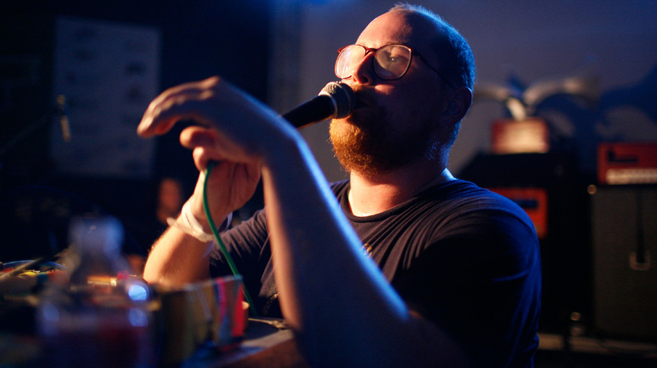 Backed by two drummers, electronic pop artist Dan Deacon needed only a table full of electronics and a ringleader's personality to launch a wild dance party at NPR Music's SXSW Showcase.  (Katie Hayes Luke for NPR)