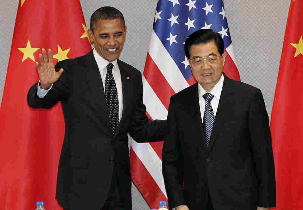 President Obama greets Chinese President Hu Jintao at the start of their meeting in Seoul, South Korea, on Monday. The U.S. president asked the Chinese leader to use his influence with North Korean to discourage that country from launching a rocket next month.