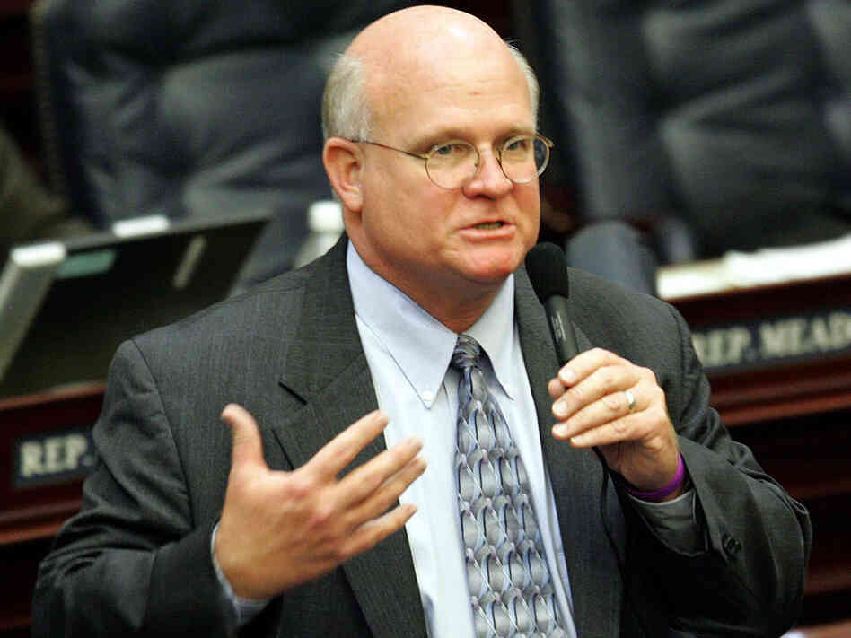 Rep. Dennis Baxley, R-Ocala, explains the protection of persons/use of force bill during House session, Thursday, March 31, 2005, in Tallahassee, Fla. The bill passed on House vote. Baxley joins