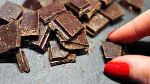 Researchers say some compounds in cocoa may help us fend off fat.