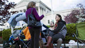 Outside the Supreme Court on Sunday, some of those who were lined up to get seats inside the courtroom.