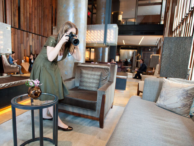 Kelsey Blodget of Oyster.com photographs the lobby of New York's Trump SoHo hotel. The website relies on tech-savvy workers to create online reviews