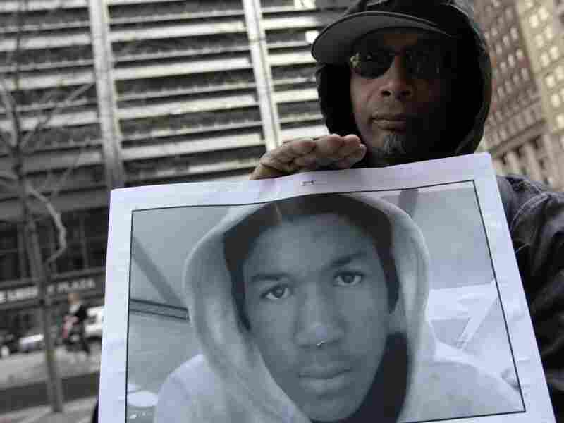 Steven Bishop, of Raleigh, N.C. holds a photo of Trayvon Martin during an Occupy Wall Street march and rally on Saturday (March 24, 2012) in New York City.
