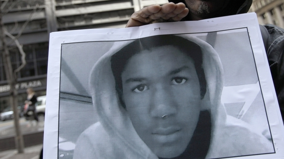 Steven Bishop, of Raleigh, N.C. holds a photo of Trayvon Martin during an Occupy Wall Street march and rally on Saturday (March 24, 2012) in New York City. (AP)