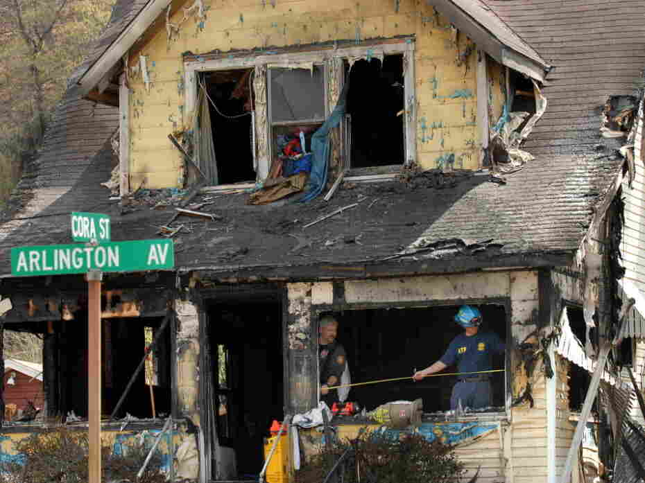 On Saturday, investigators sifted through debris in the aftermath of a house fire in Charleston, W.Va., that has now claimed nine lives.
