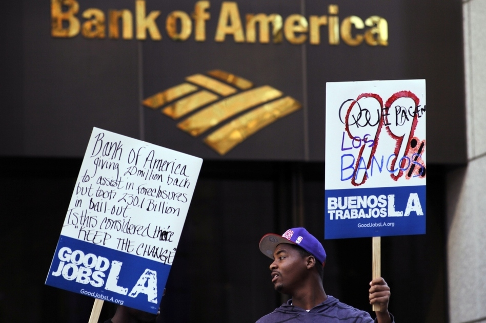 Occupy L.A. activists rally outside the Bank of America Plaza in Los Angeles in February. The Occupy protests around the country have inspired two working groups that are attempting to reform the banking system and create an alternative bank.
