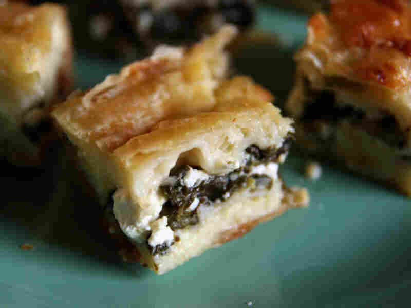 Creamy Phyllo Spinach Borek: This rich borek is sliced into small squares for serving.