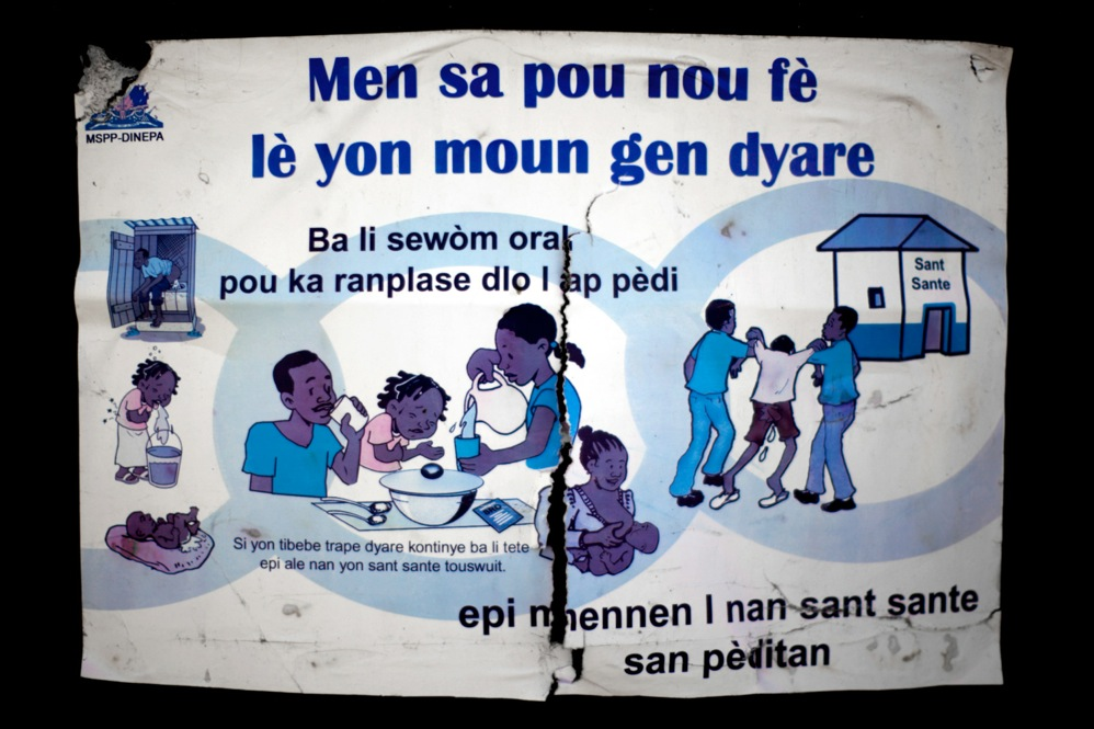 A sign produced by Haiti's water authority warns about the dangers of diarrhea and shows how to treat it -- lots of fluids and a trip to a health clinic.