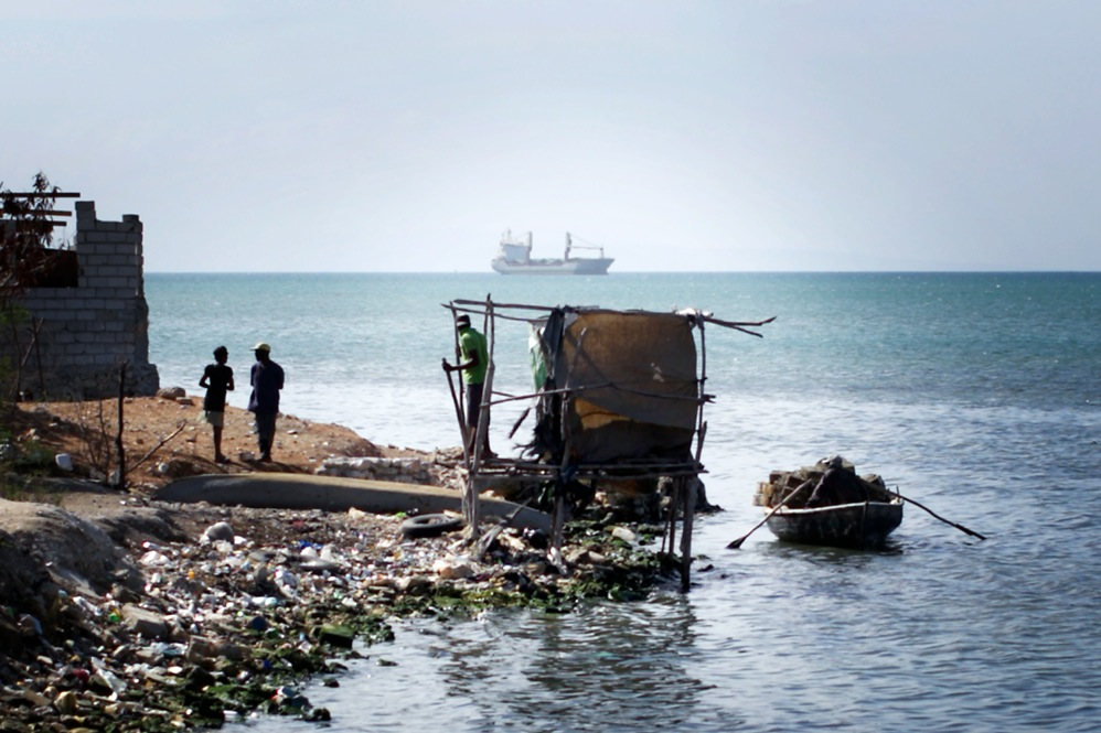 A makeshift latrine hangs over Port-au-Prince Bay at the edge of Cite de Dieu.