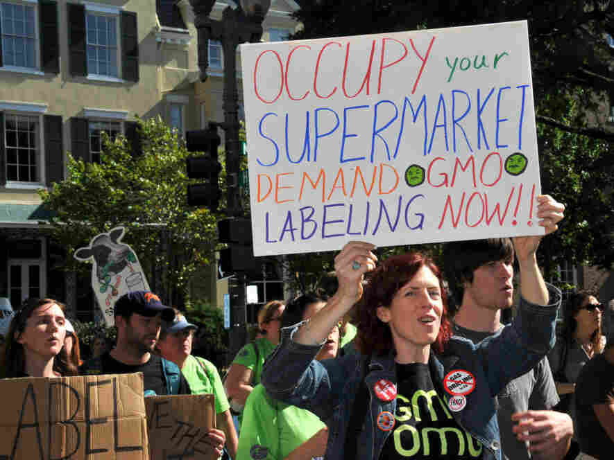 People march demanding labels for genetically modified food near the White House in Washington, D.C., on Oct. 16, 2011.