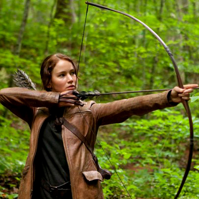 Jennifer Lawrence aims an arrow in The Hunger Games. The central character of the film based on Suzanne Collins' books relies on her ability with a bow to survive.