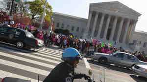 While some reporters inside scrambled to get word out, there were plenty of protesters and spectators outside the Supreme Court this morning.