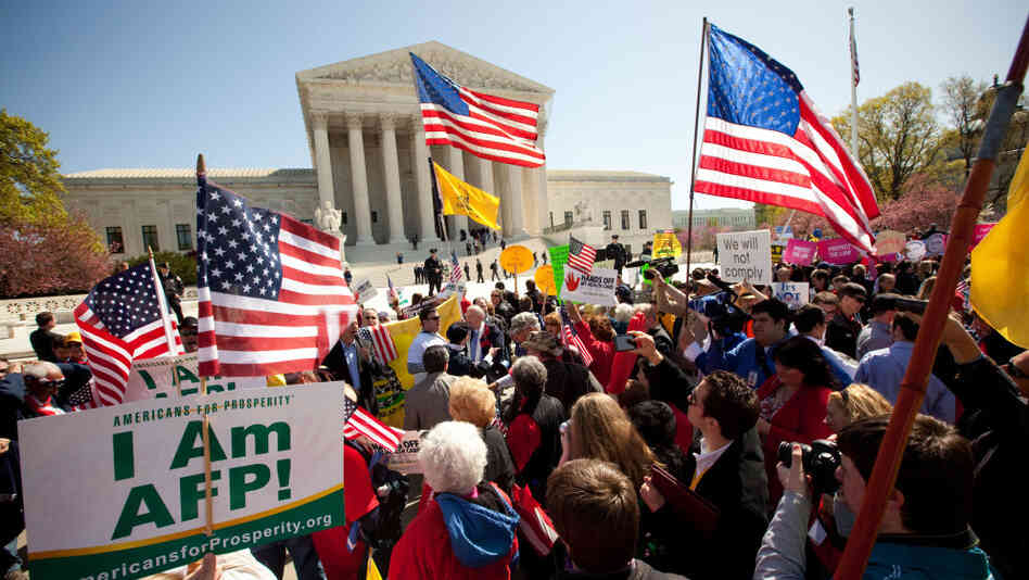 Demonstrators both for and against the new health care law turned out on the steps of the Supreme Court on Tuesday.