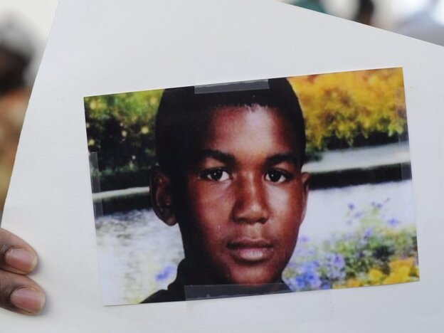 This photo of Trayvon Martin was held by a supporter during a recent rally in the Goldsboro neighborhood of Sanford