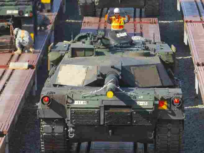 US M1A1 tanks of 11th Armor Cavalry Regiment from the National Training Center at Fort Irwin, California, US, are loaded onto trains at Camp Carroll in Waegwan, southeast of Seoul on March 3, 2011.