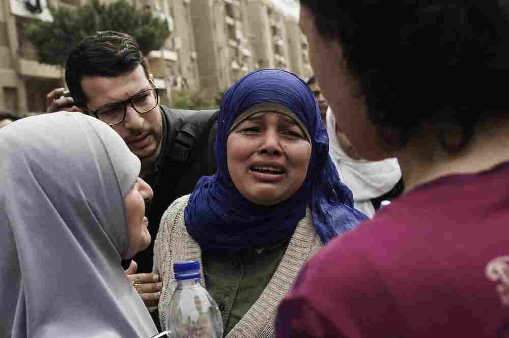 "Samira Ibrahim, an Egyptian woman who brought the case against an army doctor accused of conducting forced ""virginity checks"" on female protesters last year, breaks into tears outside a military court in Cairo on March 11 after hearing that the doctor was acquitted."