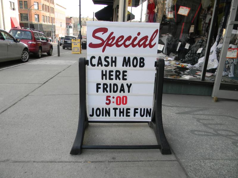 """Lander's clothing store in Jamestown, N.Y., prepares for a """"cash mob"""" to descend last week."""