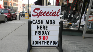 "Lander's clothing store in Jamestown, N.Y., prepares for a ""cash mob"" to descend last week."