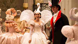 Irrepressibly warmhearted Snow White (Lily Collins), usually kept under lock and key by her wicked-queen stepmother, makes an appearance at a ball with the dreamy, easily befuddled Prince Charmi