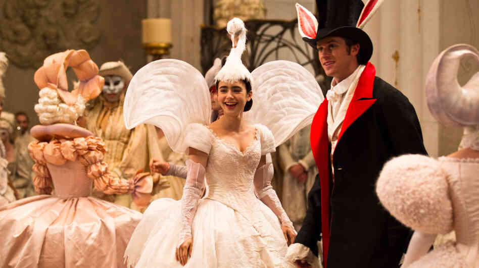 Irrepressibly warmhearted Snow White (Lily Collins), usually kept under lock and key by her wicked-queen stepmother, makes an appearance at a ball with the dreamy, easily befuddled Prince Charming (Armie Hammer).
