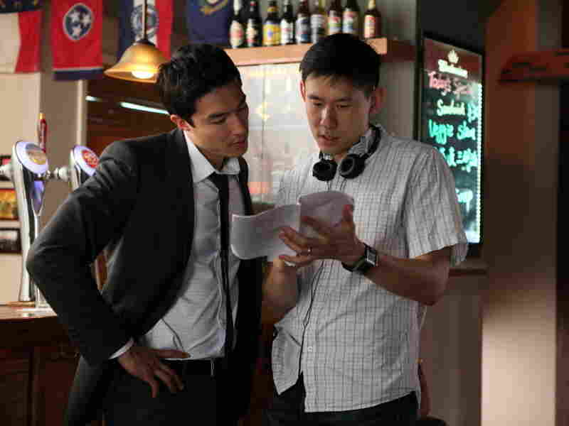 Director Daniel Hsia (right) talks with Henney on the set of Shanghai Calling.