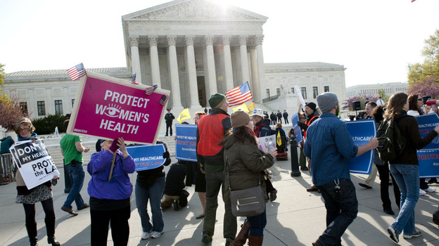 Activists gather in front of the U.S. Supreme Court on Wednesday as the court hears a third day of arguments on President Obama's health care law.  (UPI /Landov)