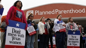 "Local citizens and employees of the Planned Parenthood clinic in San Angelo, Texas gather in front of the clinic Thursday, March, 8, 2012 to participate in the ""Don't Mess with Texas Women"" rally."