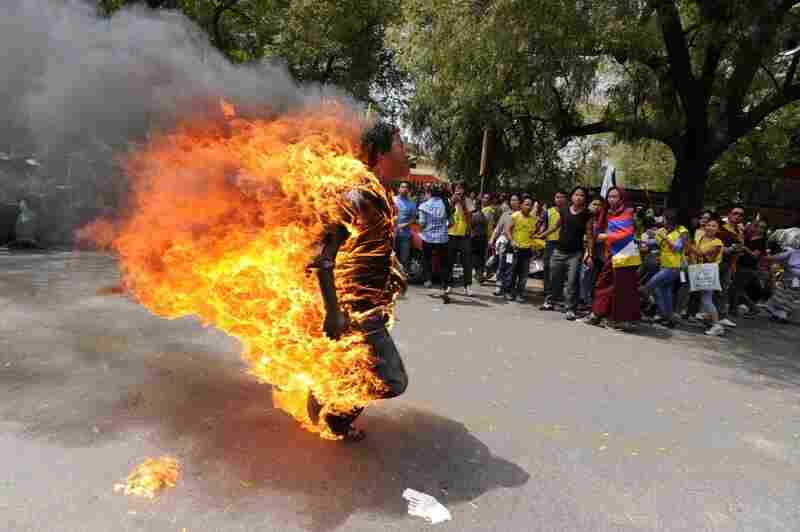 Tibetan exile Janphel Yeshi, 27, is engulfed in flames after he set himself on fire during a protest in New Delhi on March 26, 2012.