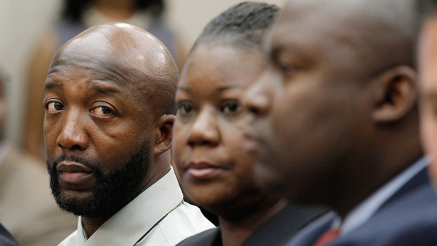 Tracy Martin (left) and Sybrina Fulton appear at a forum held by Democratic members of Congress in Washington on Tuesday. Lawmakers discussed the death of the couple's son, Trayvon Martin, and racial profiling.  (Getty Images)