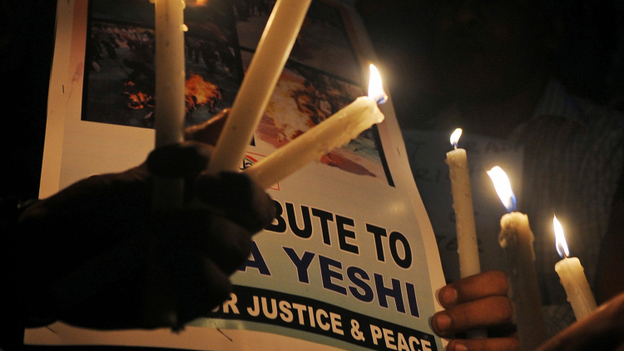 In Kolkata on Tuesday, exiled Tibetans and human rights activists held a candlelight for Jamphel Yeshi. (AFP/Getty Images)