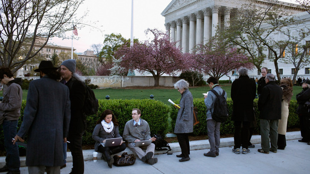 People wait for tickets to attend the last day of arguments over the Affordable Care Act at the Supreme Court. (Getty Images)