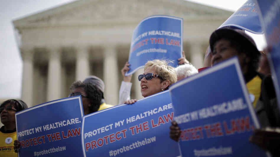 Supporters of the health care law rally in front of the Supreme Court Wednesday, the final day of arguments over its constitutionality.