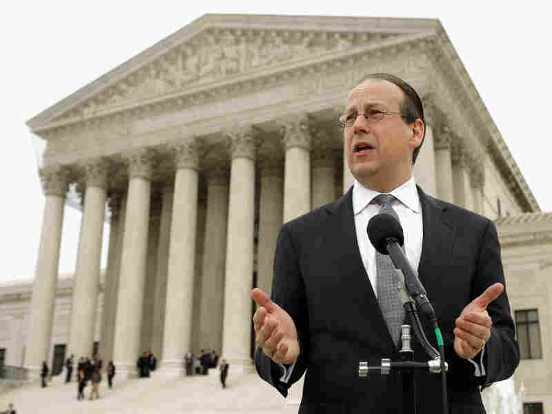 Paul Clement, the attorney representing the 26 states challenging the Patient Protection and Affordable Care Act, talks to the news media outside the U.S. Supreme Court on the third day of oral arguements over the constitutionality of the act March 28, 2012 in Washington, D.C.